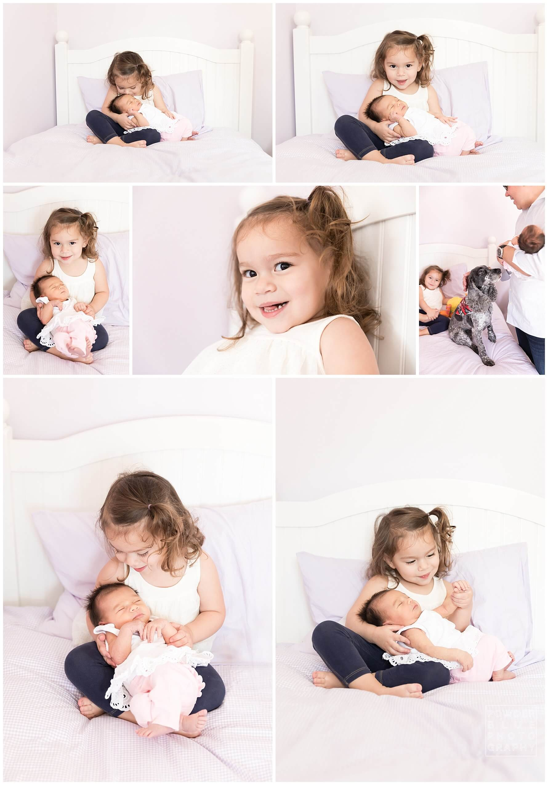 pittsburgh newborn photographer. simple, natural newborn portrait in studio on a white bed. baby girl. sister. no props.